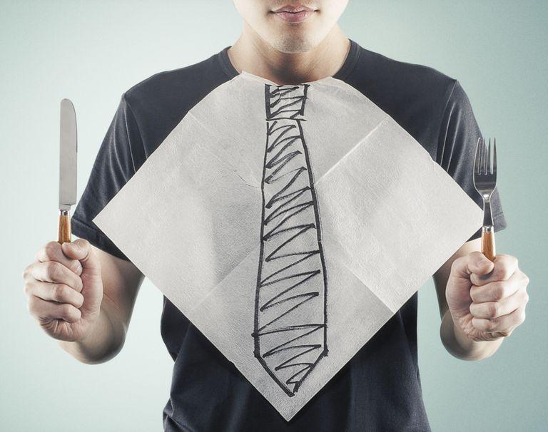 man with a bib that has a tie drawn on it