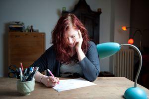 Woman writing at desk
