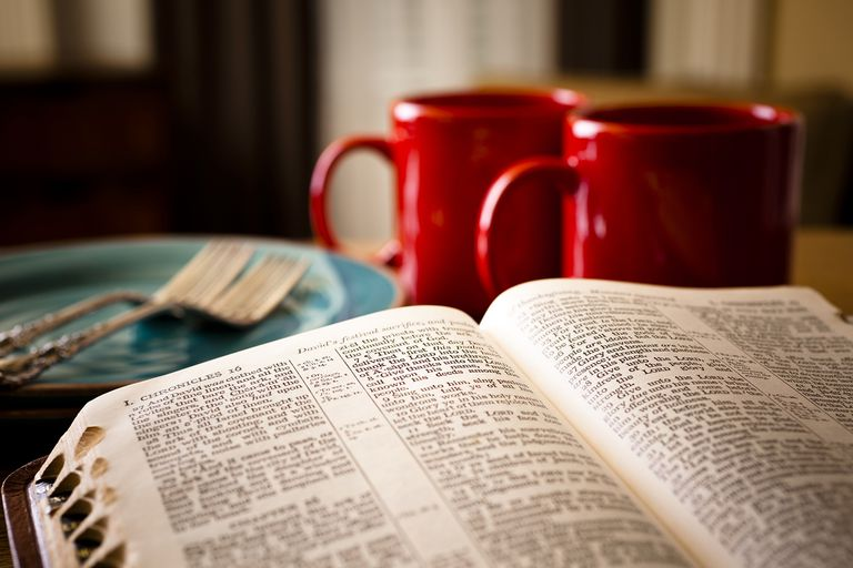 Bible and Coffee Set for Two With Red Mugs Plates