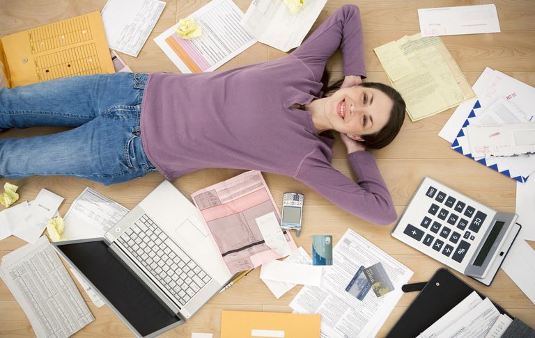 Smiling woman with financial paperwork