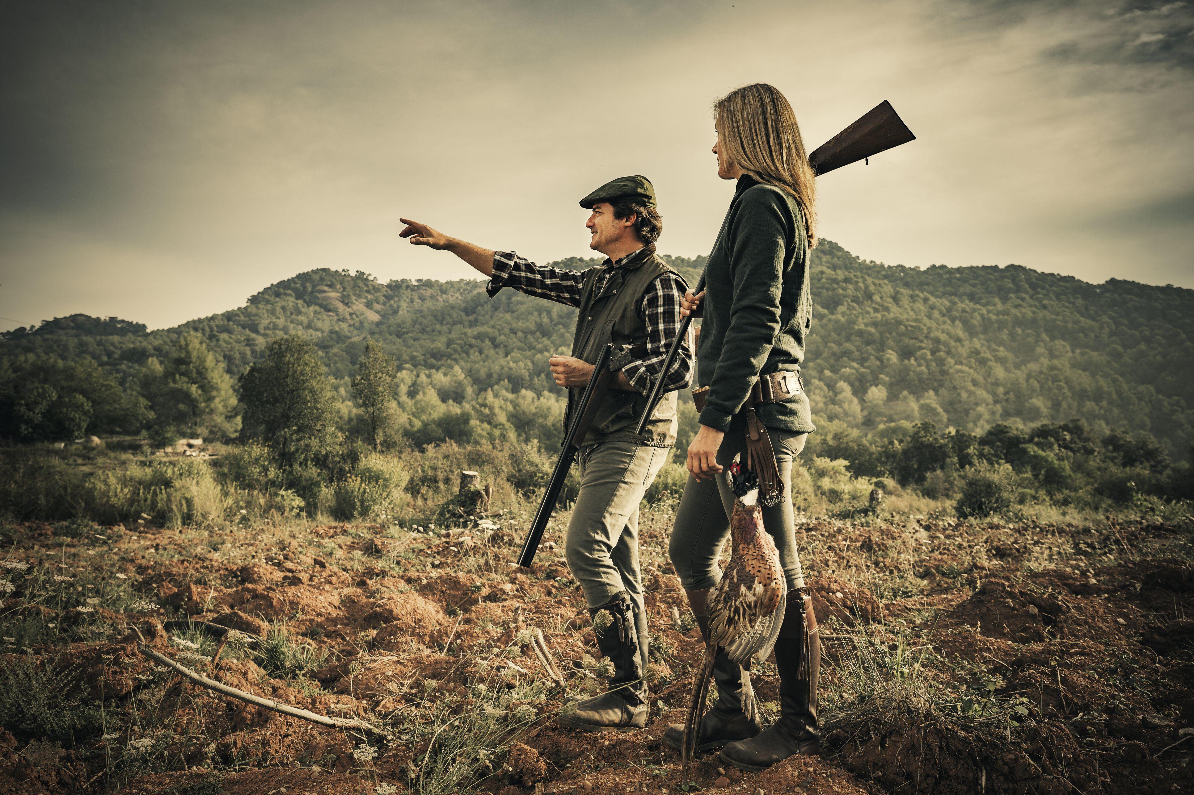 Man and woman hunting pheasants