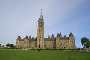 Canadian Parliament building against a blue sky.