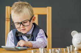 Little Boy Using a Calculator
