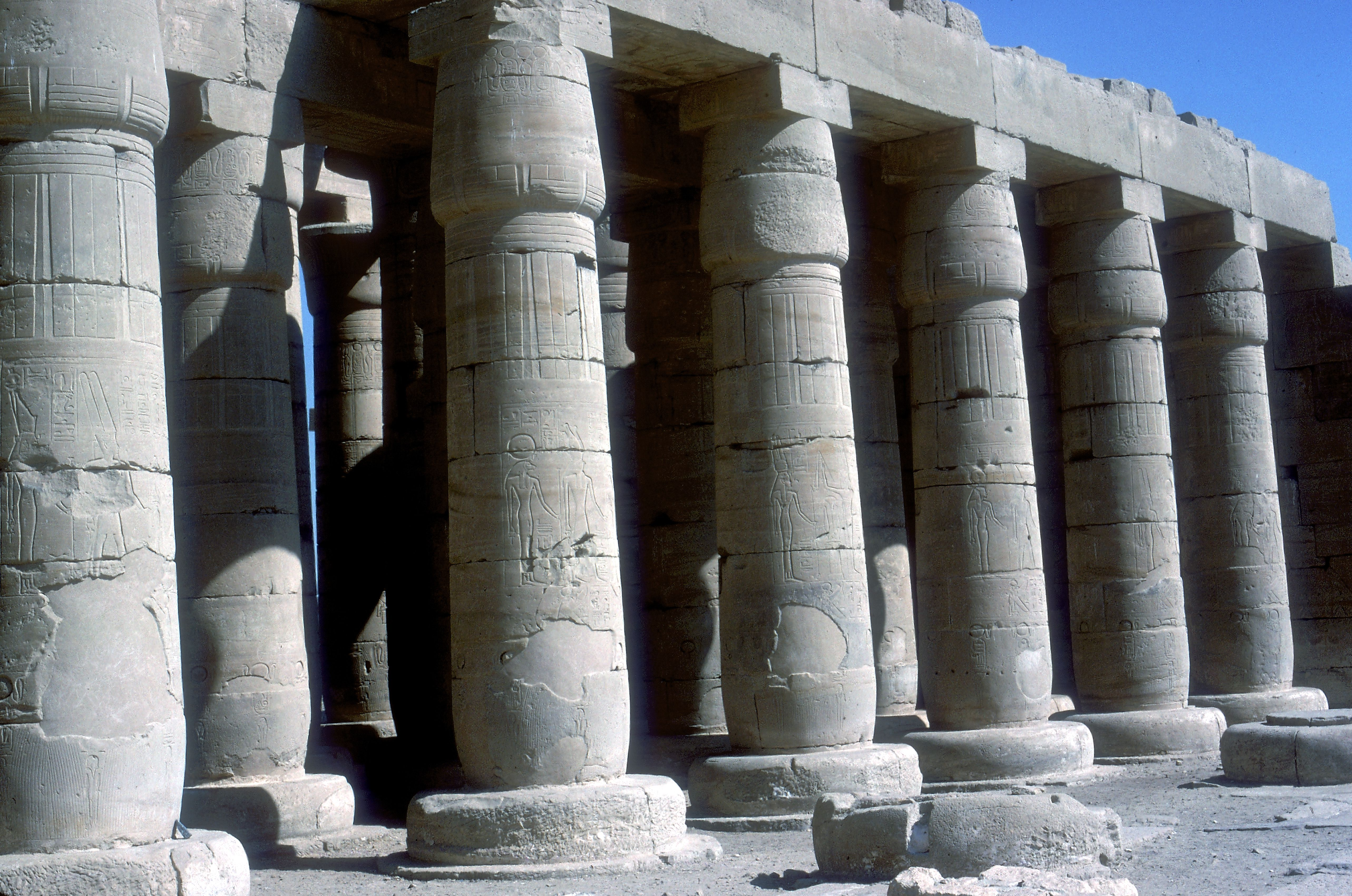 ancient, massive Egyptian columns, tapered, large tops and bottoms