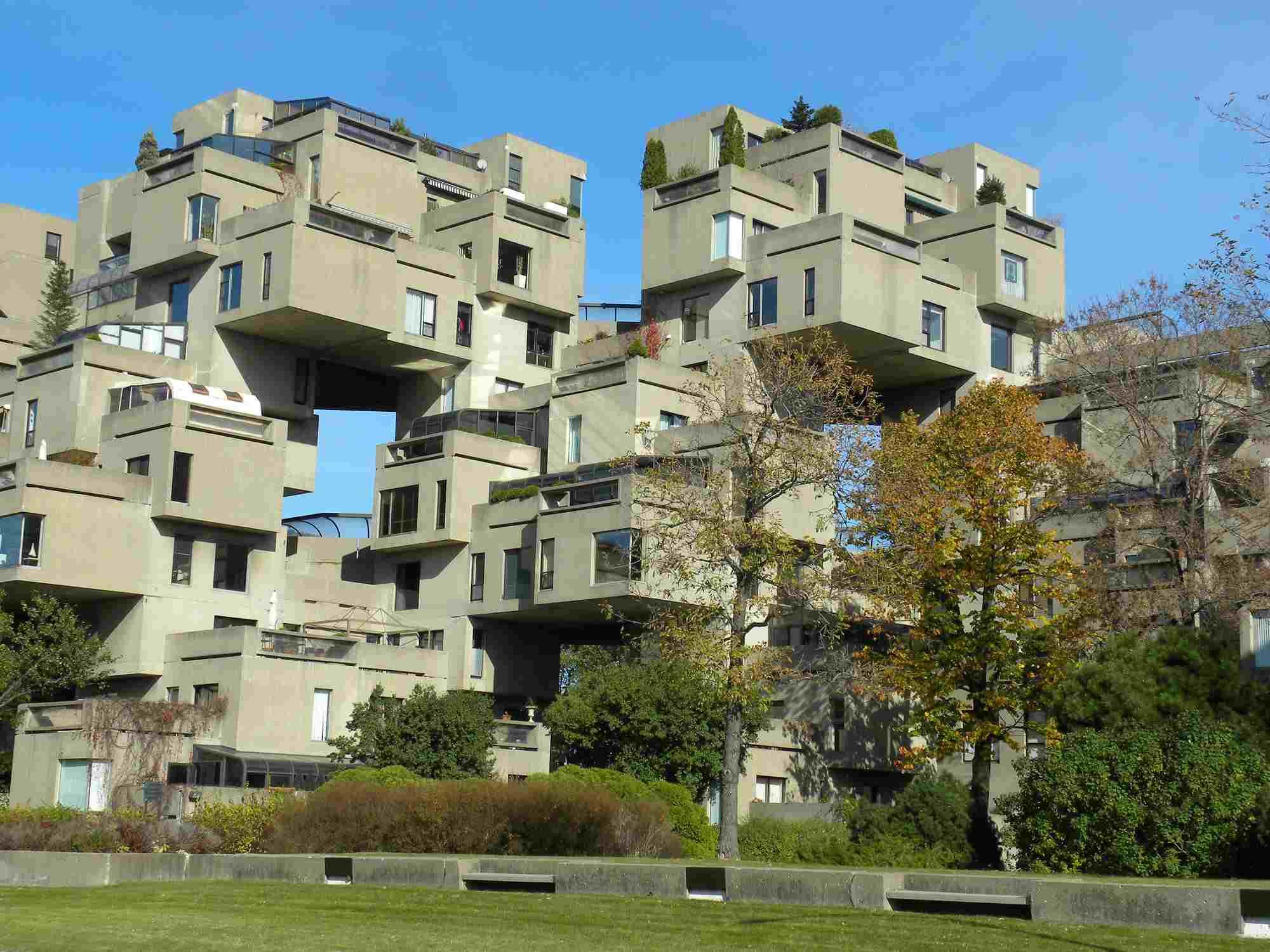 Photo of box-like apartment units, individually and randomly stacked.