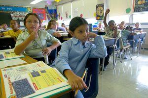 Children sitting in desks in a classroom
