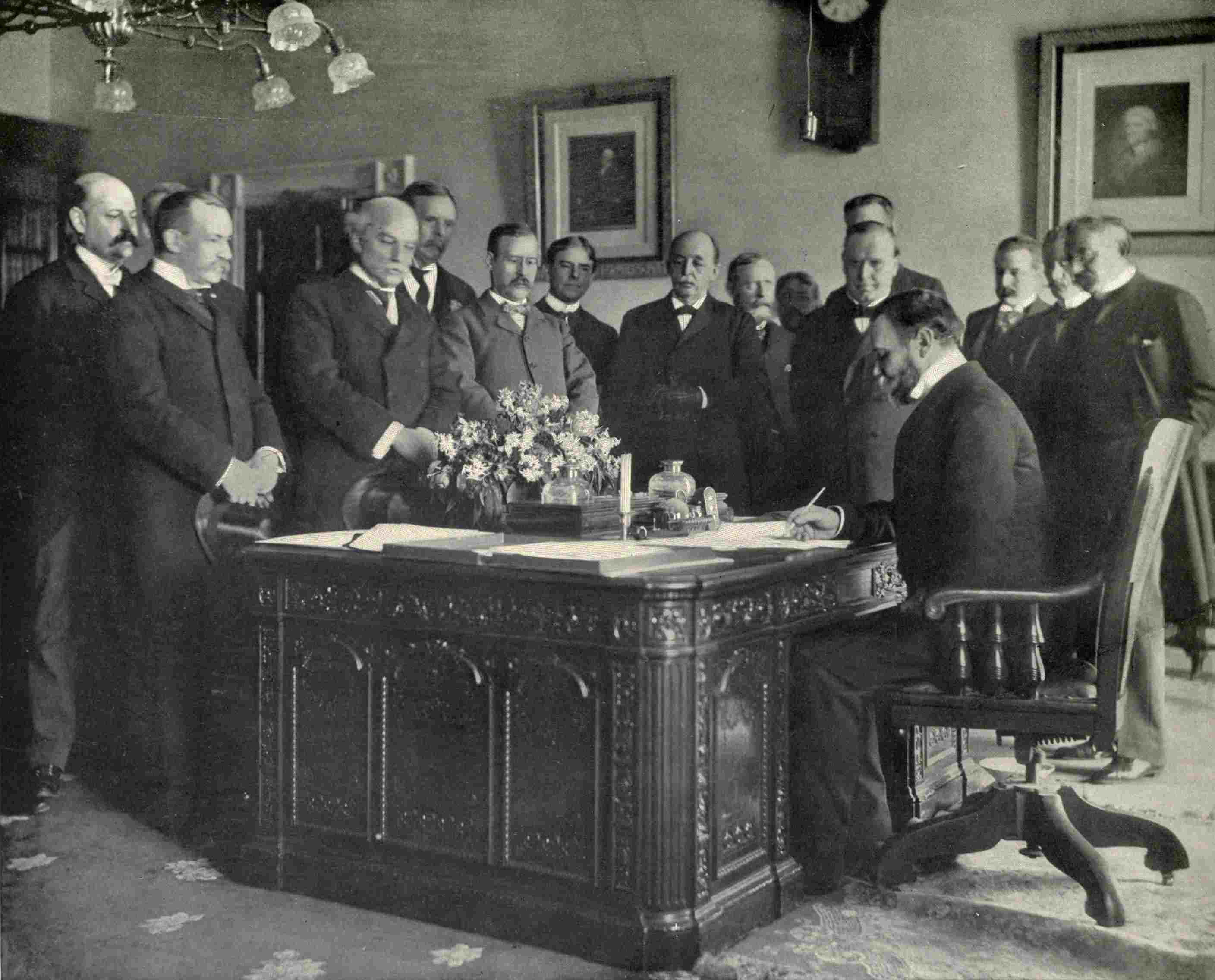John Hay, Secretary of State, signing the memorandum of ratification for the Treaty of Paris that ended the Spanish American war on behalf of the United States