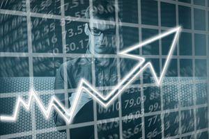 Man calculating an economic equation, digital imagery.