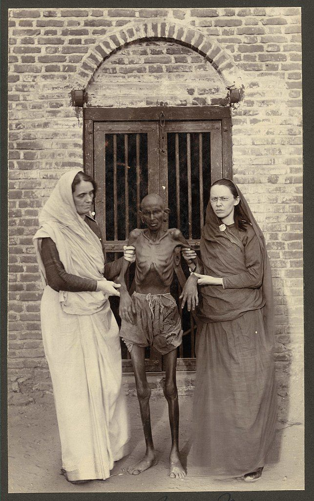Miss Neil [and] a famine victim, India