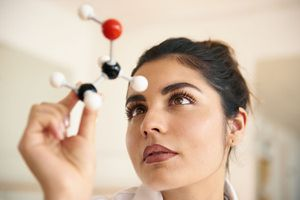 Woman Holding Molecular Model of Ethanol