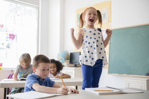 Student shouting at desk in classroom