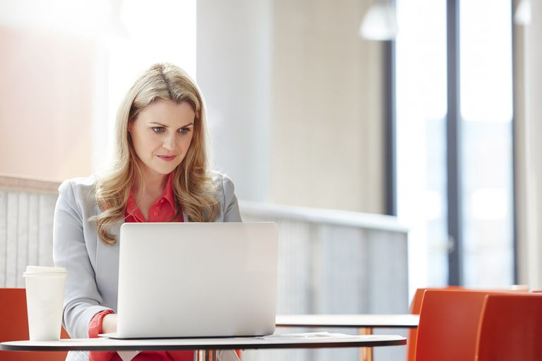 Woman on laptop in office