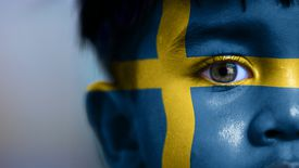 Boy with Swedish flag painted on his face