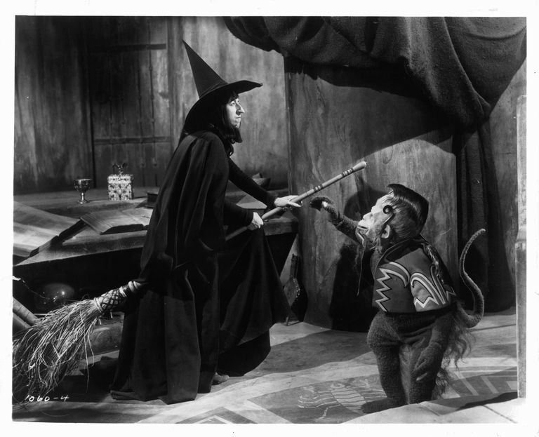 "The Wicked Witch on a broom next to her flying monkey in ""The Wizard of Oz."""