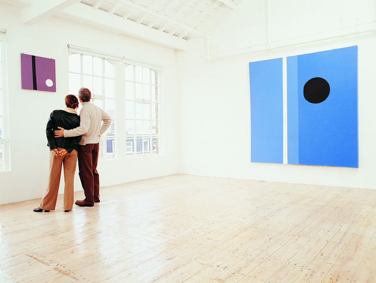 Couple Looking at a Painting in an Art Gallery