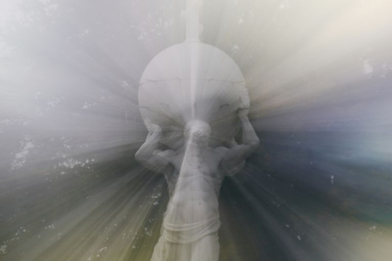 Digital Composite Image Of Greek God Statue With Light Beam