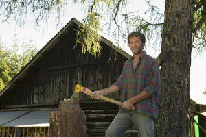 Young man chopping wood