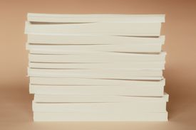 Stack of recycled white paper, paper supplies