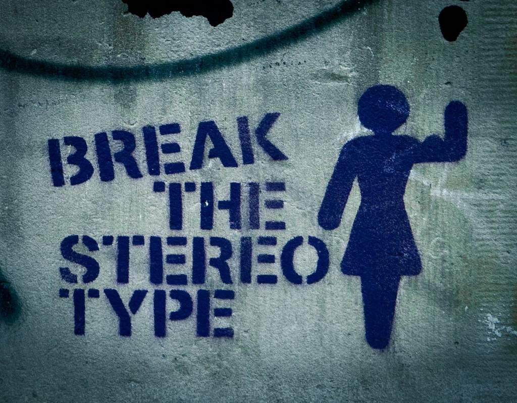 "Graffiti sign bearing the slogan, ""Break the Stereotype"""