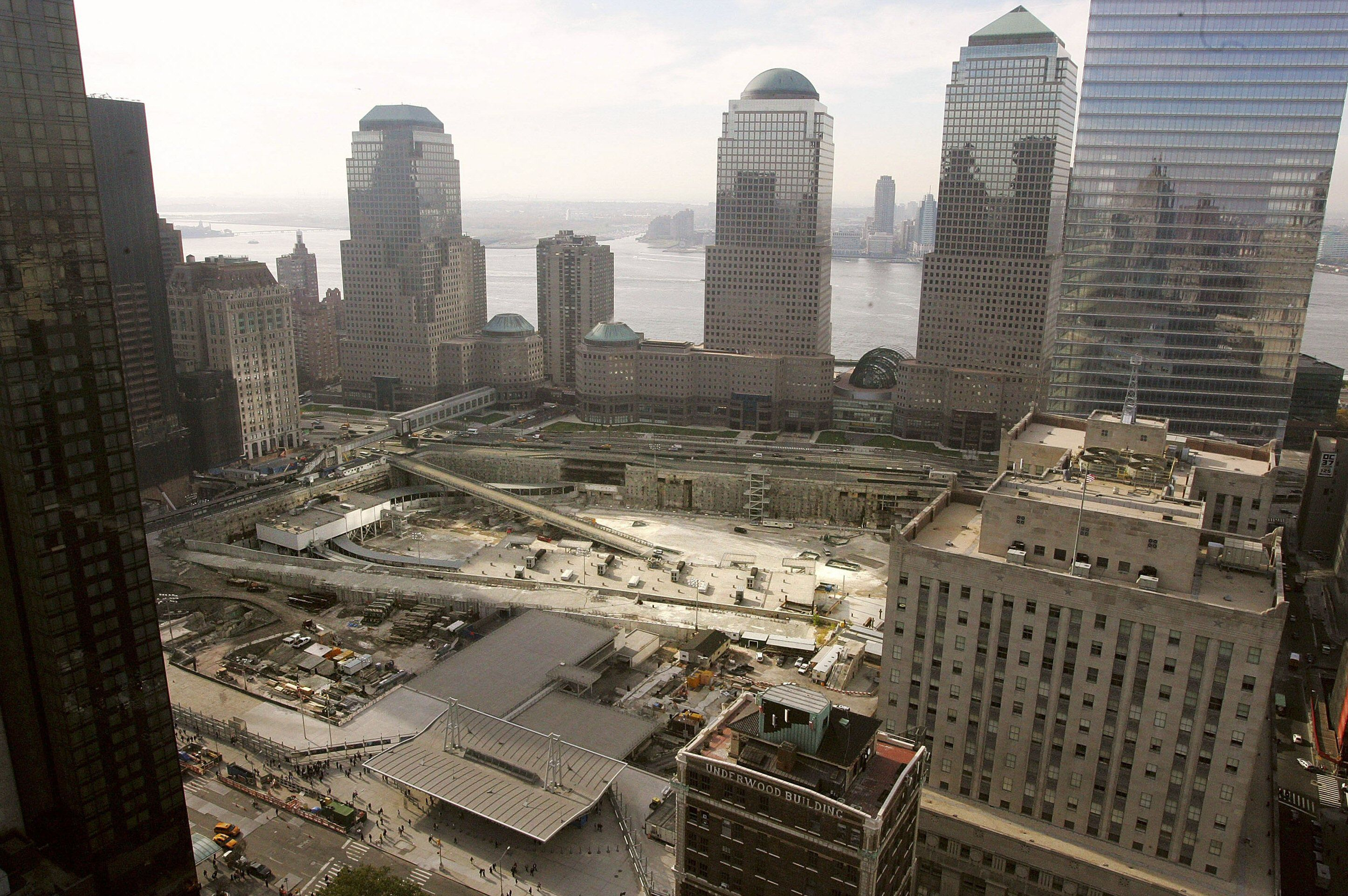 barren construction site with skyscrapers and the Hudson River in the background