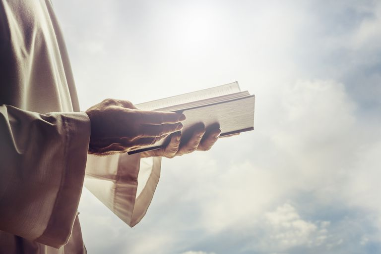 Man reading from Bible
