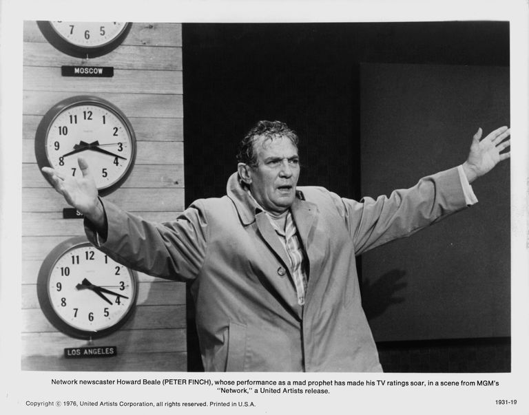 Peter Finch as news anchor Howard Beale delivering a hortatory address in Network (1976)