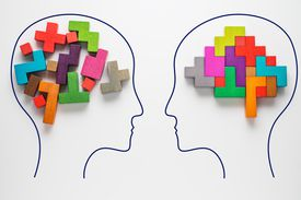 Heads of two people with colorful shapes of abstract brain