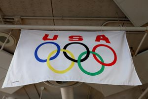 USA and Olympic rings on a flag hanging from rafters