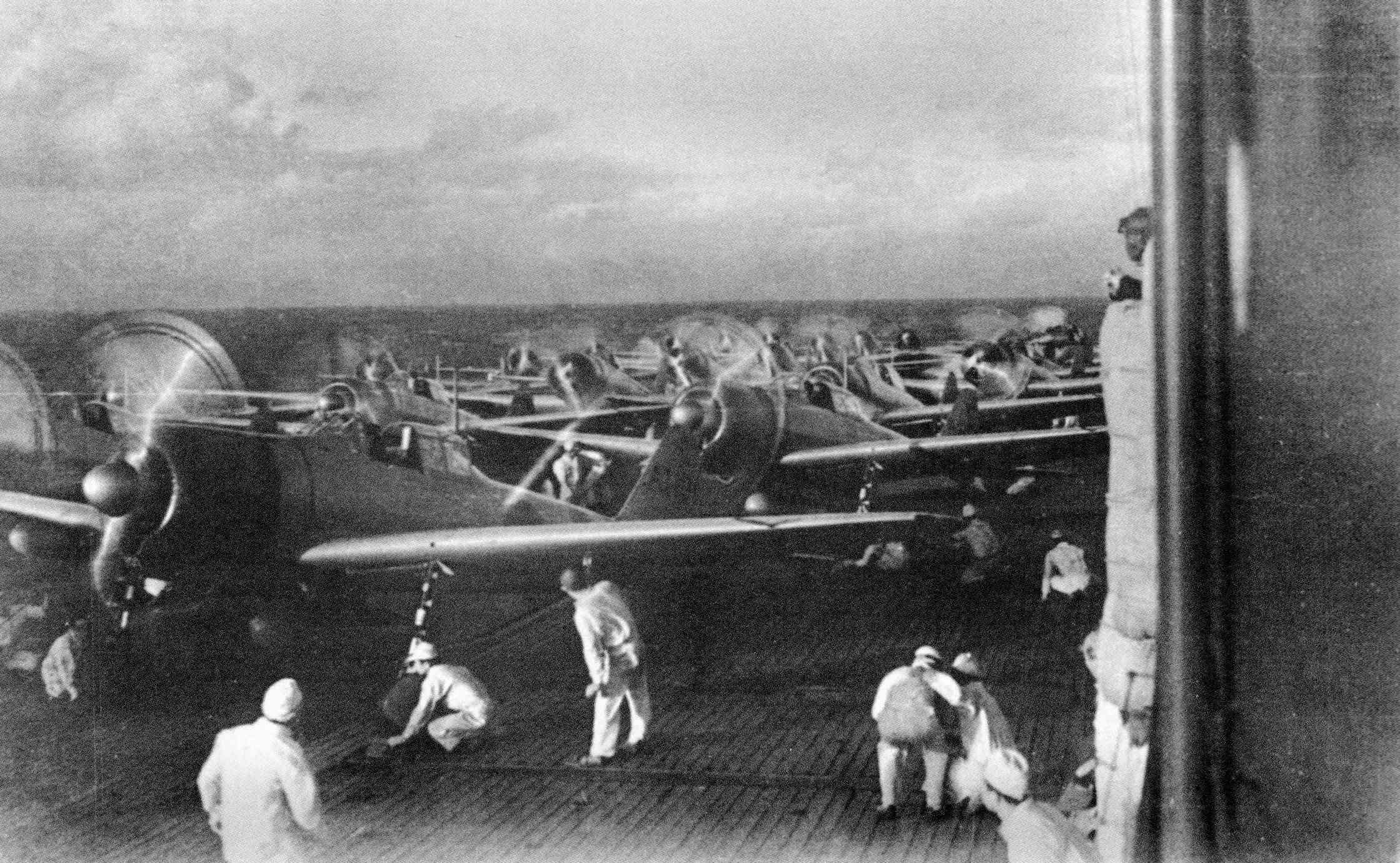 Propeller aircraft preparing to take off from Akagi, 1941.