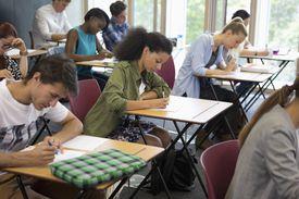 University students taking exam in classroom