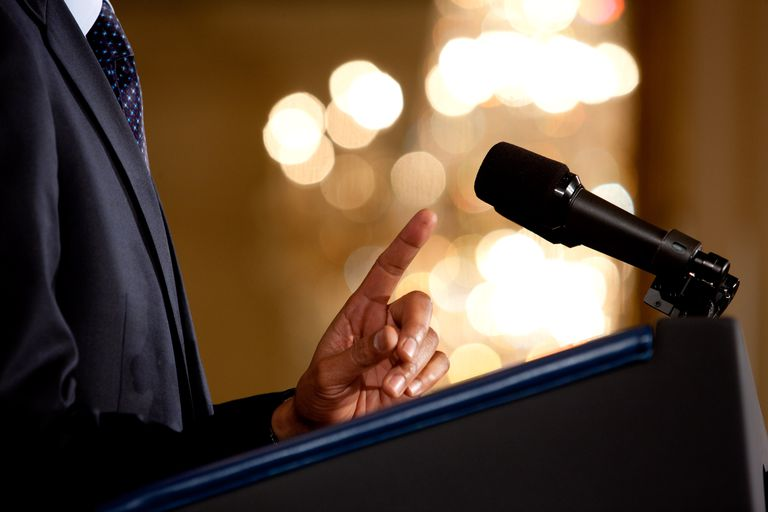 Obama at podium holding one finger up