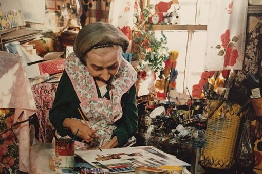 Maud Lewis painting in her home in Nova Scotia