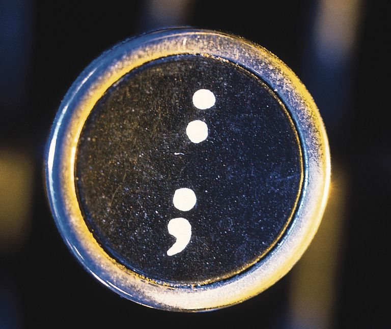 Colon and semicolon on typewriter key