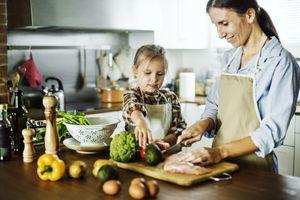 Mother slicing vegetables
