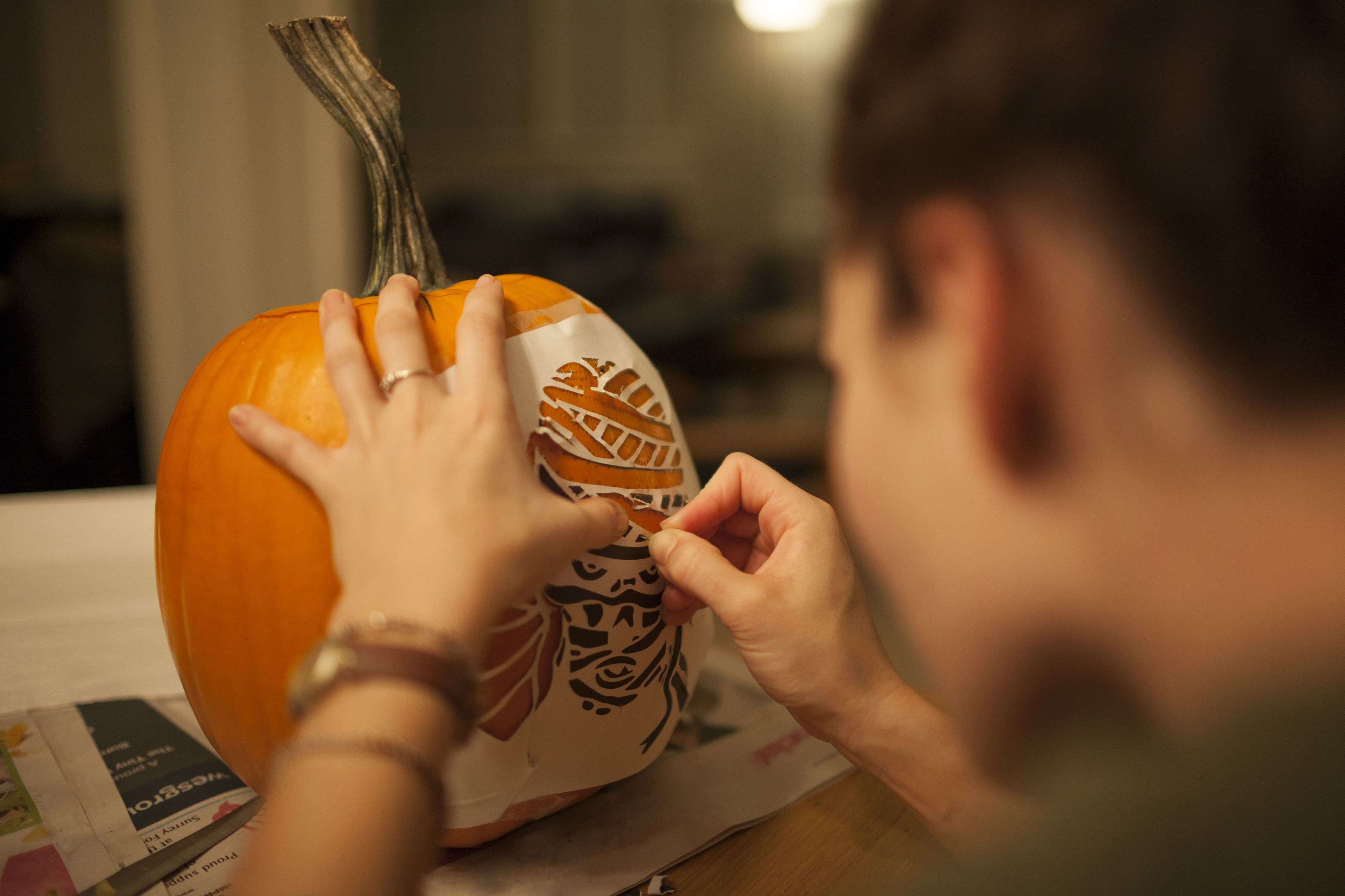 how to attach a stencil to your halloween pumpkin