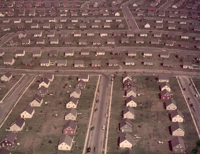 Cape Cod houses lined streets and cul-de-sac in Levittown, New York. Circa 1950s.