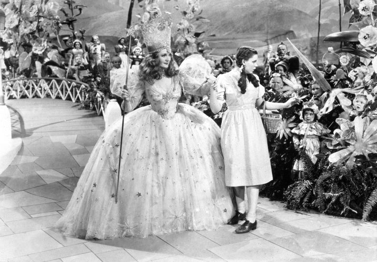 Glinda and Dorothy amongst the munchkins in the Wizard of Oz.