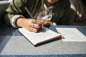 businesswoman writing on train