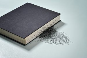 Letters falling out of a book