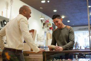 Young man buying item