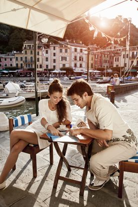 Couple studying over coffee at a riviera cafe