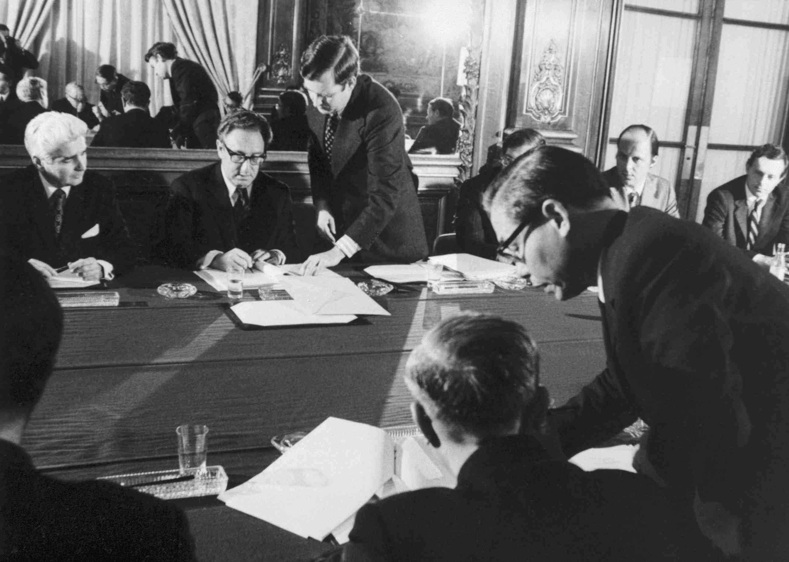 Sec. of State Henry Kissinger signing the Vietnam War cease fire
