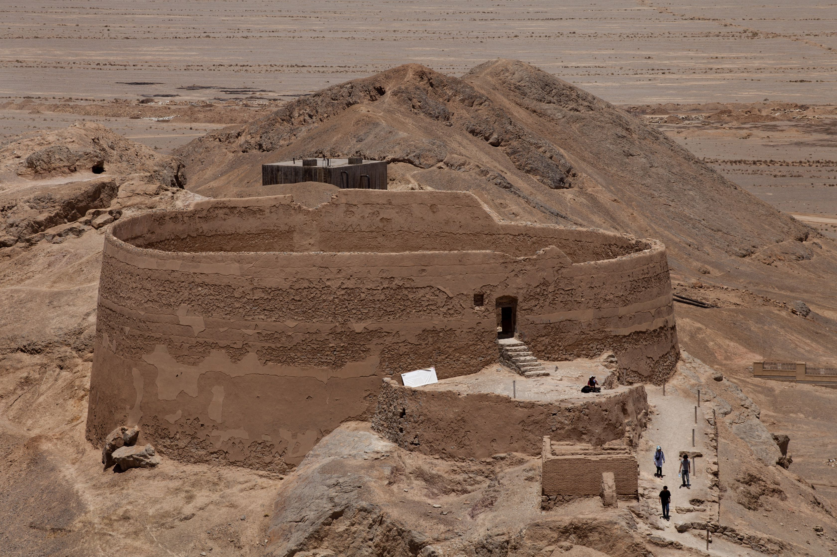 large, earthen cylindrical structure, like a big kettle