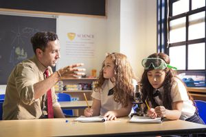 Teacher Helping Students with a Science Experiment
