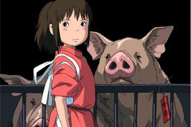 Shen stands near her parents, who have been turned into pigs
