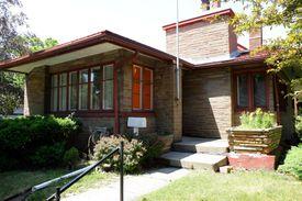 modern one story, large chimney, multiple windows