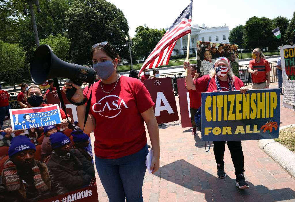 Immigration activists with the advocacy group CASA rally at the White House to demand President Biden grant citizenship for immigrants.