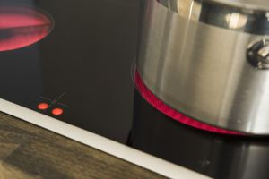 Conduction transfers heat through a burner element, while convection heats the food cooking in the pot.