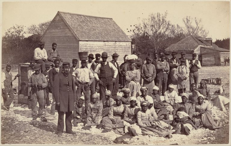 Photograph of American slaves on a farm.
