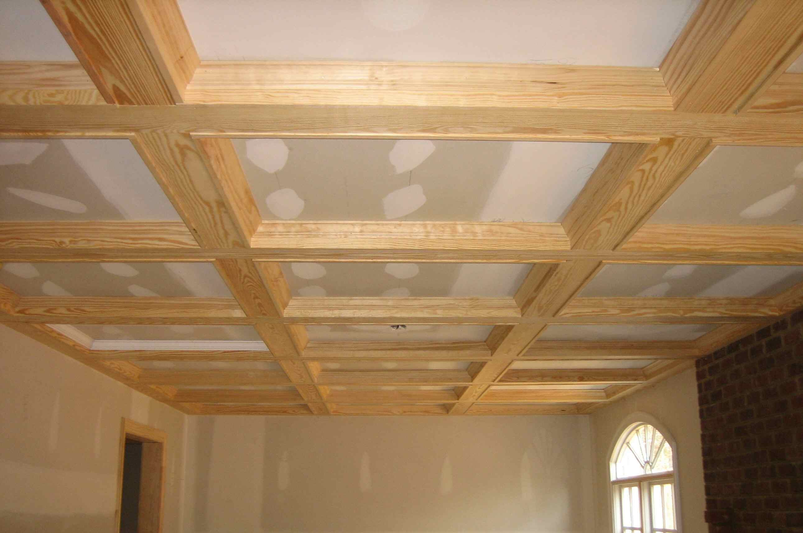 Unfinished cross and beam ceiling creating coffers unfinished coffered ceiling